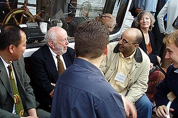 Douglass North chats with participants on boat