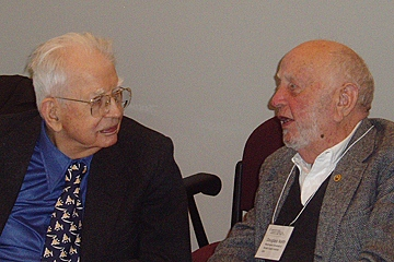 Ronald Coase and Douglass North talk together at the 2004 Chicago conference