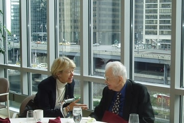 Ronald Coase and Mary Shirley talk at lunch