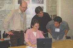 Participants share ideas on a computer