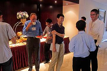 Participants talk durng icoffee break