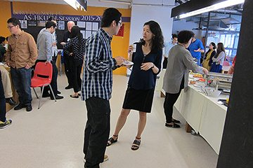 Participants talk during coffee break