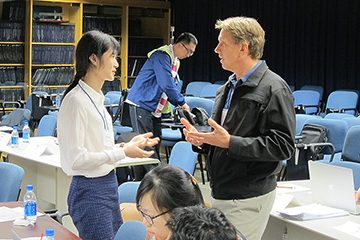 Participants and faculty discuss ideas